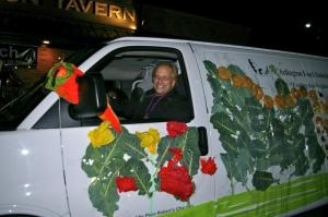 Last year's AFAC van in the Mardi Gras parade with Executive Director Charlie Meng driving