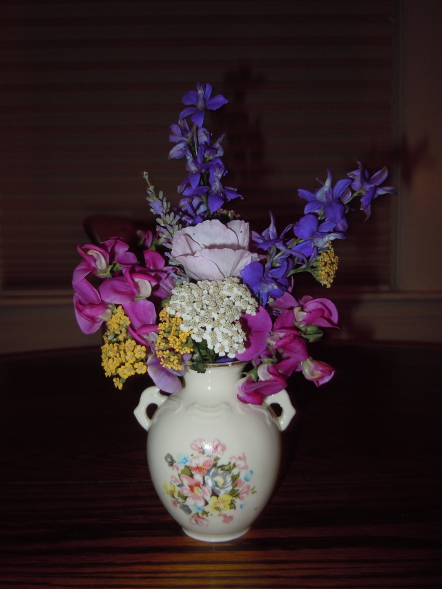 My mother sent me this small vase for my birthday.  It will come in handy for the profusion of sweet peas I usually have.
