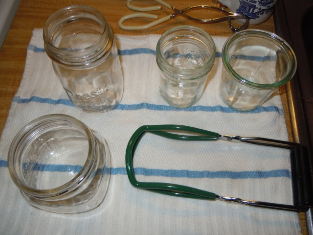 My sterilized jars, resting on a clean towel with the jar grabber.
