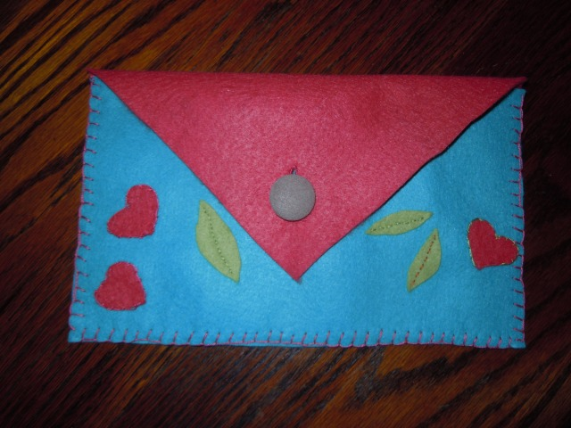 Having bought the candies, I needed packaging for them, so made this envelope, with a button from my favorite dress of all time...