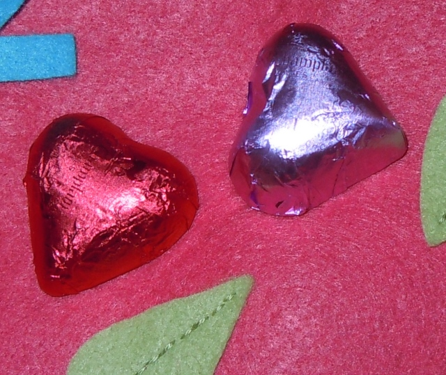 Dark Lake Champlain chocolate hearts, one with a chocolate raspberry ganache filling...