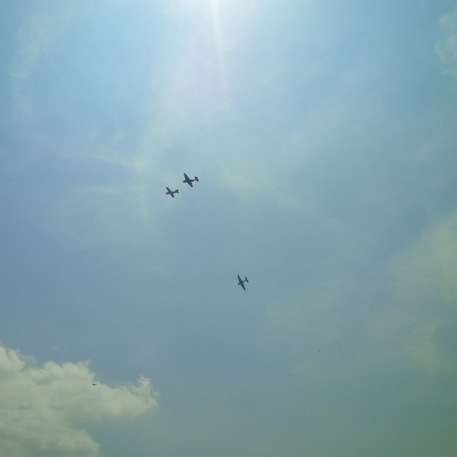 I think this is representing Leyte Gulf--two Grumman Avengers and one Curtiss Helldiver.  It's not a lost man formation--I think this is the plane that had to land at National Airport because of engine trouble.