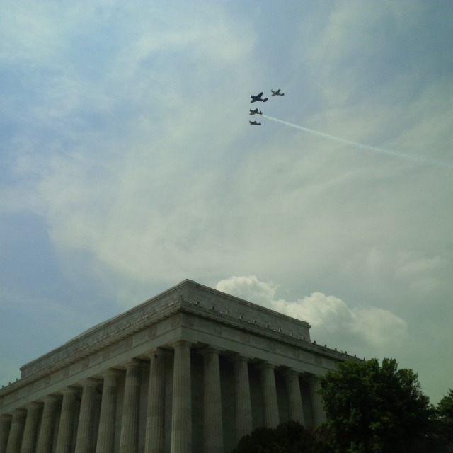 Missing Man formation, still together, with (nearest to farthest) Mustang, Avenger, Corsair, Warhawk.