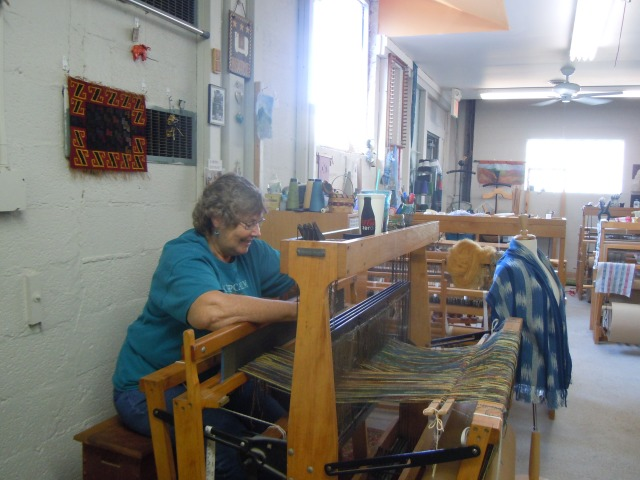 This is Linda George, spinner, weaver, and knitter, threading her loom for a wool blanket.