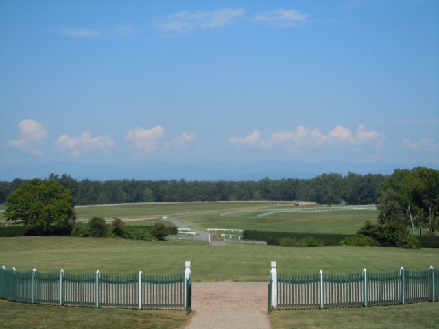 This is the view from the front porch. Between the tree line and the clouds, you can see the