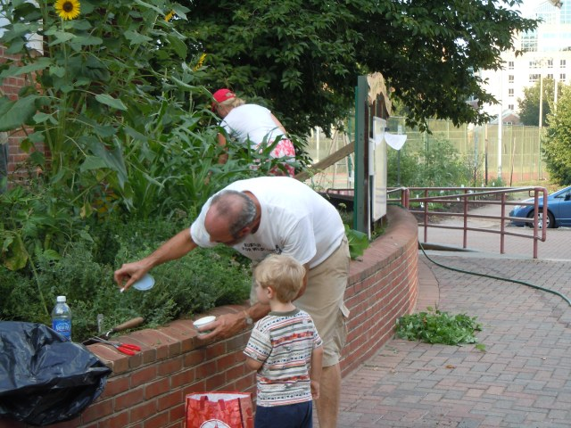Don shows a potential gardener how to release ladybugs.