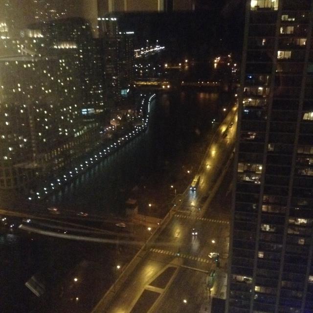 Chicago River at night, flowing toward Lake Michigan.